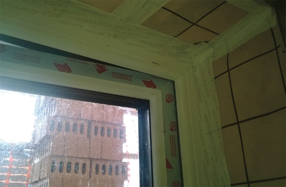 Airtightness taping over joints, while insulated window and door reveals reduce thermal bridging
