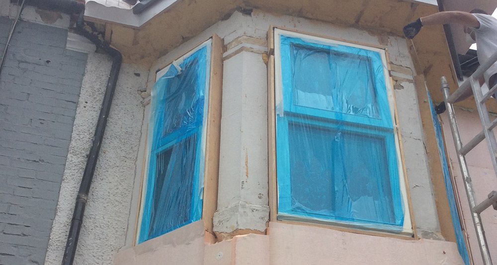 Fixing the external insulation around the two-storey bay window at the front of the house was a particular challenge.