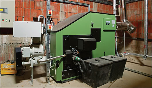 The 100kW HDG wood chip boiler that heats the factory is housed in an underground boiler house