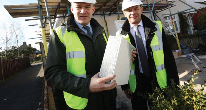 Former energy minister Ed Davey visiting a council house that received external insulation & heating system upgrade under the Energy Company Obligation (Eco) scheme in March 2015